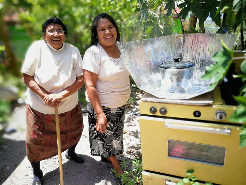 Customers with Haines solar cooker placed on gas stove