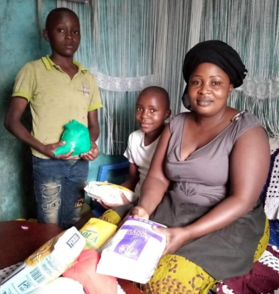 Family with donated groceries